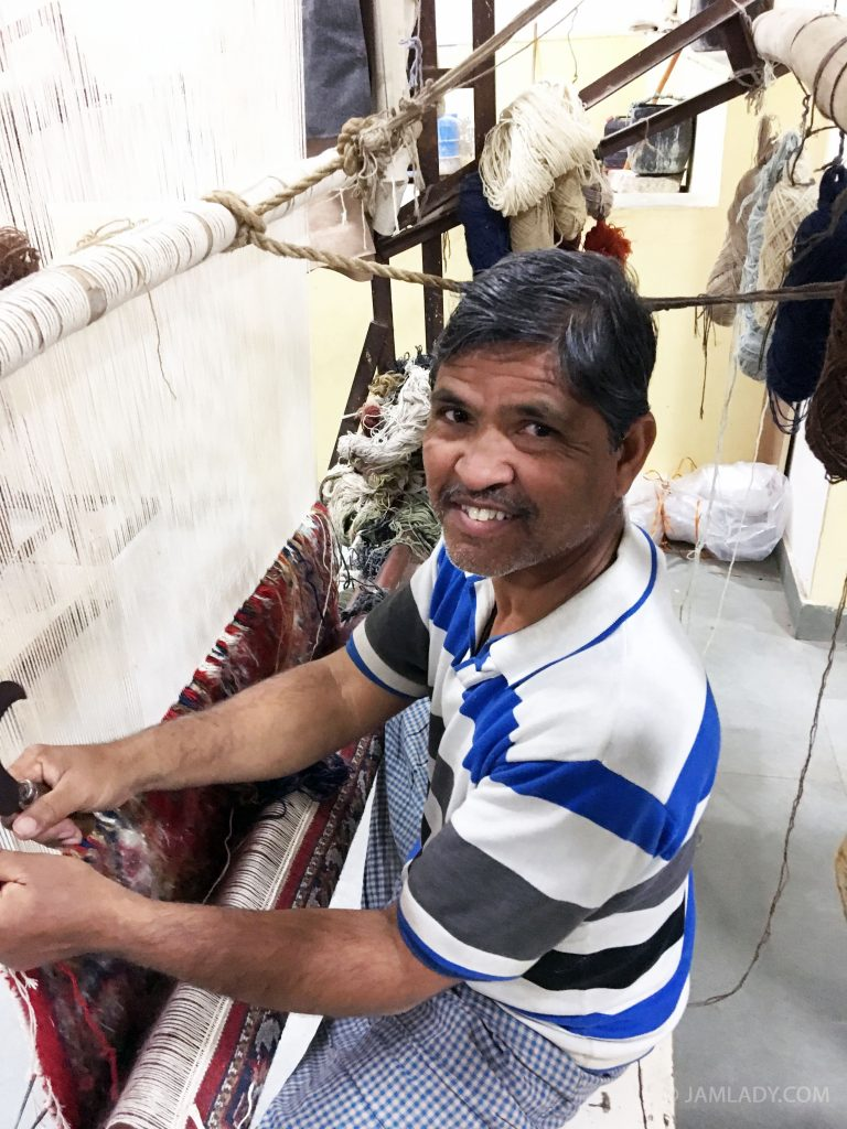 Weaving wool rugs at Sodi Textiles. Wool are dyed there with many natural dyes from indigenous plants.