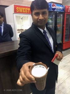 Restaurant manager offering sweet mango lassi on our 2 AM travel stop, New Delhi to Jaipur.